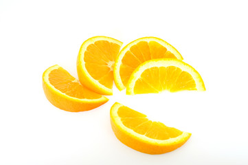 orange slices fanned out isolated on white