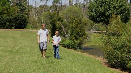 Two Brothers Walk By Pond