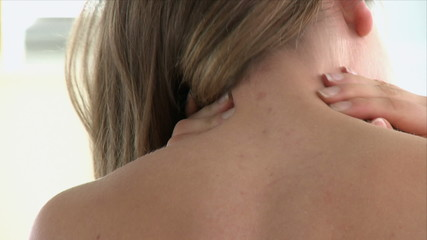 young woman massaging her neck