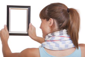 woman hanging photo frame