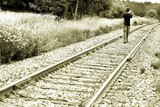 Man Walking On Train Tracks