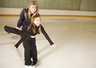 Two Girls Practicing Ice Skating Together