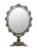 Antique mirror in front of white background