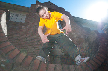 Teenage hip-hop girl on red brick wall