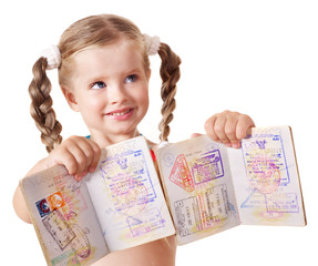 Child holding international passport. Isolated.