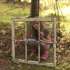 Young Girl In Woods, Looking Through Old Window