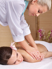 Young woman on massage table in beauty spa. Series.