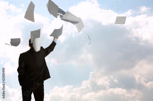 The businessman throws a pile of documents upwards, for a back
