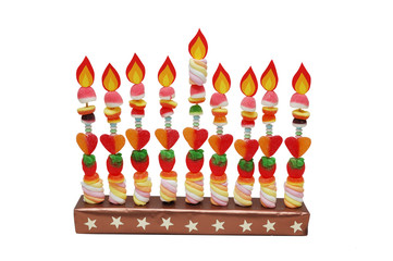 Hanukah menorah made from candies with paper flames