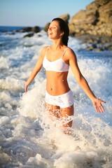 happy beautiful girl in the sea waves