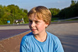 portrait of young boy at the skate park
