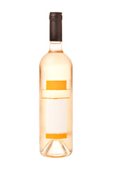 Bottle of white wine with blank label and dew isolated on white