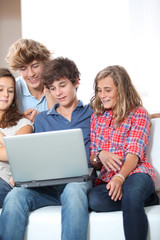 Group of teenagers at home with laptop