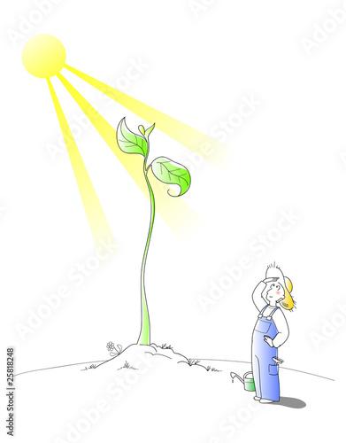Contadino che coltiva un germoglio gigante