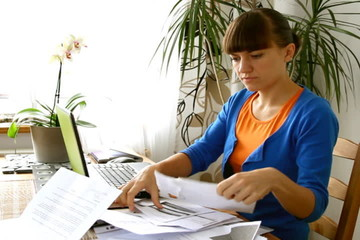 Woman working on her bills