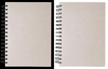 White notebook isolated on black and white