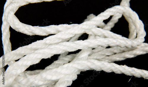 white nylon rope in black background