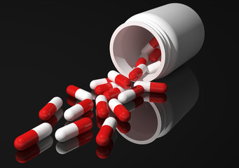 red capsules black background
