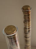 Two columns of euro coins in transparent tubes