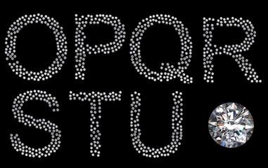 Diamond O-U letters with large gemstone
