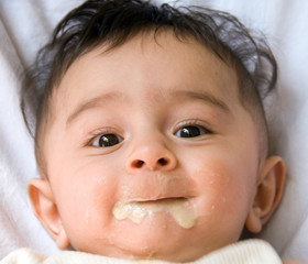 baby feeding on babyfood with spoon