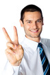 Happy businessman showing two fingers, isolated on white