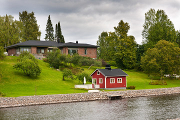 Luxury house in finland with sauna near the river.
