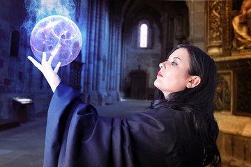 Young beautiful girl with energy sphere, sorcerer