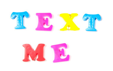 text me written in fridge magnets