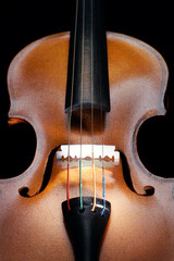 Violin close up with a razor at the place of the bridge,vertical
