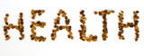 word 'health' written by almonds, hazelnuts and raisins