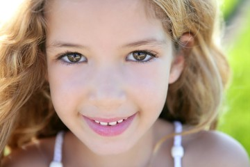 beautiful little girl portrait smiling closeup