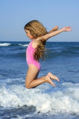 flying jump beach girl in blue sea shore