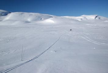 Cross-country skiers in winter landscape, Hardangervidda, Norway