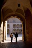 Tourist walking around Wawel royal castle in Krakow, Poland poster