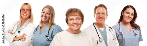 Smiling Senior Woman with Medical Doctors and Nurses Behind