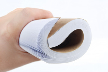 roll of book in hand