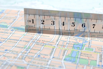 metal ruler on map