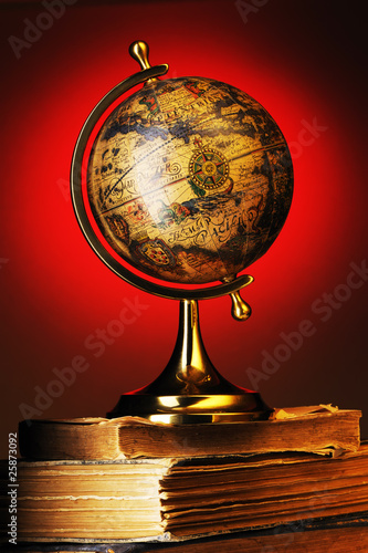 Antique globe on books