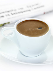 greek coffee and newspaper