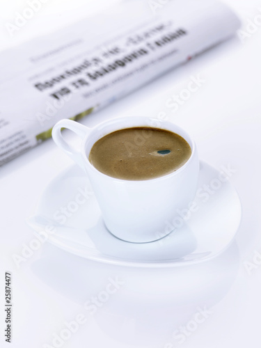 a greek coffee and a newspaper