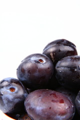 Plums in close up with space for text