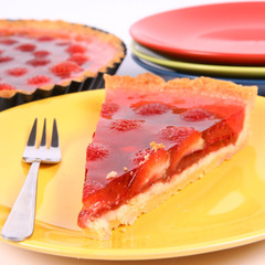 Piece of Strawberry Tart on a yellow plate