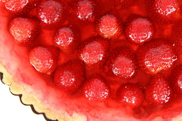 Strawberry Tart in a tart pan on a white background in close up
