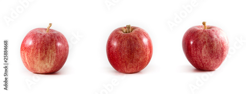 Three fresh gala apples in a line on a isolated background.