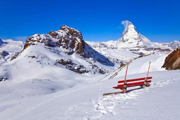 Red chair and Matterhorn Peak located in Switzerland