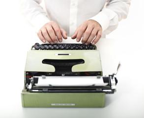detail of man with typewriter