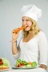 girl with salad, eating a carrot