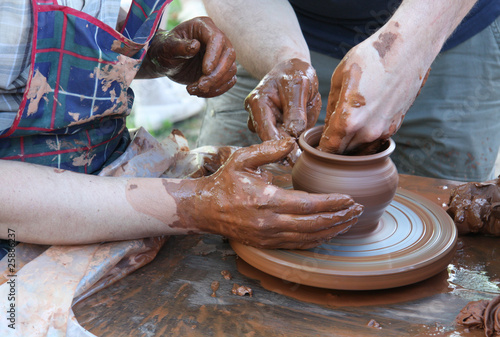 Potters hands creating a clay masterpiece