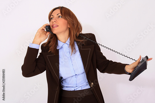 Attractive secretary speaking on the phone